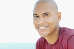 Young latino man smiling at camera Royalty Free Stock Images