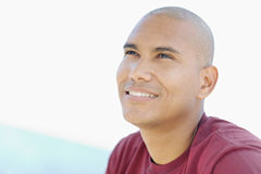 Young latino man smiling and looking up Royalty Free Stock Photo