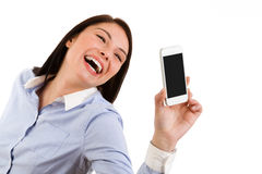 Young laughing brunette woman taking a self portrait with her ph Stock Photography