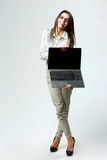 Young laughing businesswoman showing laptop Stock Images