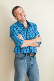Young laughing Caucasian man in casual shirt Stock Images