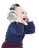 Young laughing child with ear-phones Stock Photography