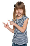 Laughing girl shows her fingers to the side Royalty Free Stock Image