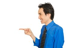 Young laughing handsome excited happy man pointing with finger stock image