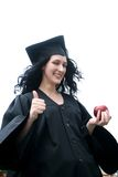 Young laughing student in gown Stock Images