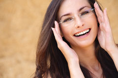 Young laughing woman wearing Royalty Free Stock Photography