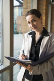 Young lawyer. Young business lady in the office is taking notes Royalty Free Stock Images
