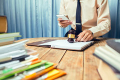 Young lawyer business man working hard top help his customer wit Stock Images