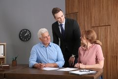 Young lawyer consulting senior couple