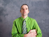 Young lawyer in green shirt with statute book. Young lawyer in green shirt and necktie with statute book Stock Photography