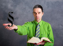 Young lawyer in green shirt with statute book and paragraph Royalty Free Stock Photography
