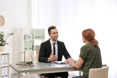 Young lawyer having meeting with senior client