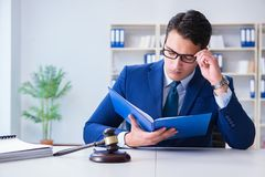 The young lawyer judge sitting in the office. Young lawyer judge sitting in the office Royalty Free Stock Image