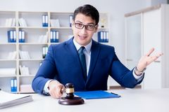 The young lawyer judge sitting in the office. Young lawyer judge sitting in the office Stock Image
