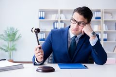 The young lawyer judge sitting in the office. Young lawyer judge sitting in the office Stock Images