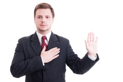 Young lawyer making oath or swearing gesture Stock Image
