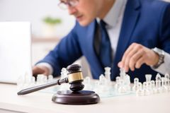 Young lawyer playing chess to train his court strategy and tacti. Cs royalty free stock photography