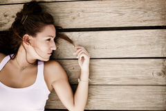 Young laying woman Stock Image