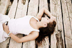 Young laying woman Royalty Free Stock Photography