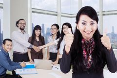 Young leader with business people in the office Stock Photography