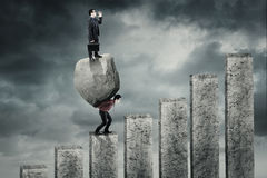 Young leader shouted above stone on the chart Royalty Free Stock Photo