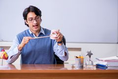 The young lecturer teacher teaching anatomy. Young lecturer teacher teaching anatomy royalty free stock photography