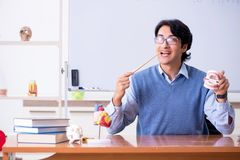 The young lecturer teacher teaching anatomy. Young lecturer teacher teaching anatomy stock photos