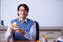 The young lecturer teacher teaching anatomy. Young lecturer teacher teaching anatomy stock photography
