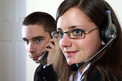 Young lefhanded boy and woman offering help desk Stock Photography