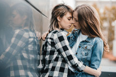 Young lesbian couple hugging and kissing outdoors Royalty Free Stock Image