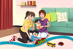 Young lesbian parents playing with their kids Royalty Free Stock Images