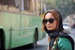 Young liberal woman in Iran. Young liberal Iranian woman with sunglasses and veil, on the street of Shiraz, capitol of Fasr province in Iran, considered to the Stock Image