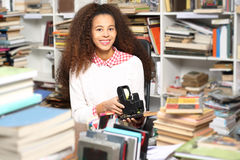 The young librarian. Library, young smiling librarian, book labels Stock Images