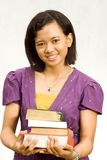 Young librarian with stack of literature Stock Photo