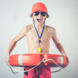 Young lifeguard. With lifebelt and whistle Stock Photography