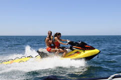 Young Lifeguards Couple on a Jet Ski Stock Images