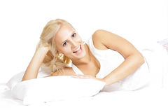 Young Light hair female model, relaxing in the bed Stock Images