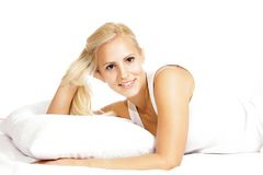 Young Light hair female model, relaxing in the bed Stock Photography