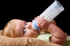Young little baby drinking from his bottle Stock Photography