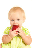 Young little baby eat   apple   Royalty Free Stock Image