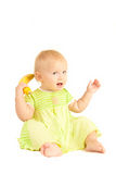 Young little baby eat yellow banana   Stock Image