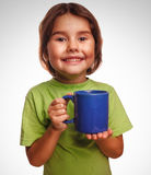 Young little baby girl drinking milk glass mug Royalty Free Stock Photos