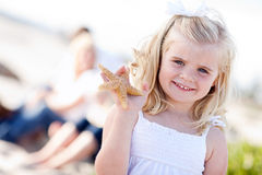 Young Little Blonde Girl with Starfish Royalty Free Stock Photo