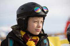 Young little boy in black ski sport protection helmet end goggles. royalty free stock photos