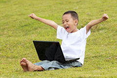 Young little boy celebrating success Stock Photography