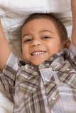 Young little boy in checkered shirt and jeans. Young little boy in shirt Royalty Free Stock Photo