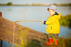 Young little boy fishing from wooden dock.  Stock Photography