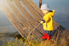 Young little boy fishing from wooden dock.  Stock Images