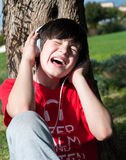 Young little boy listening to music Royalty Free Stock Photography