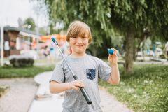 Young little boy playing mini golf royalty free stock photos